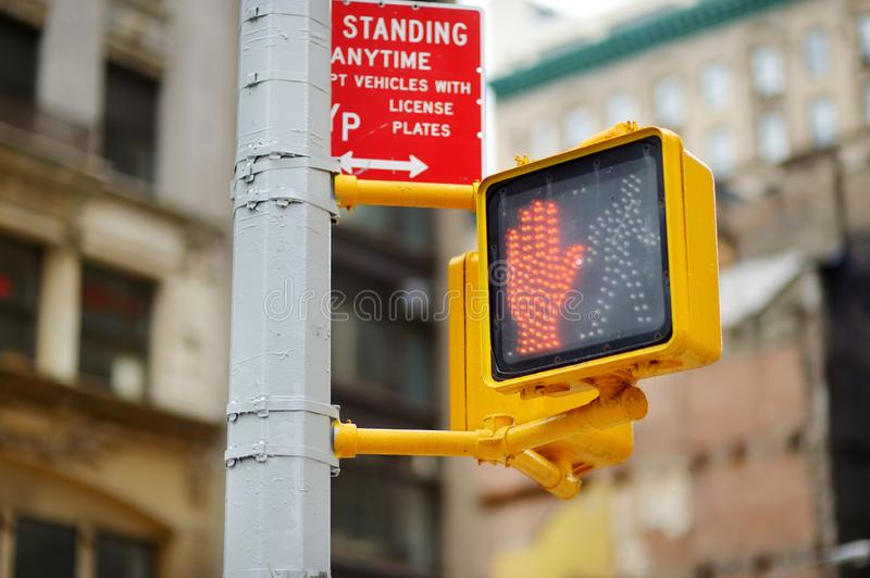 Don`t walk New York traffic sign on blurred background royalty free stock photography