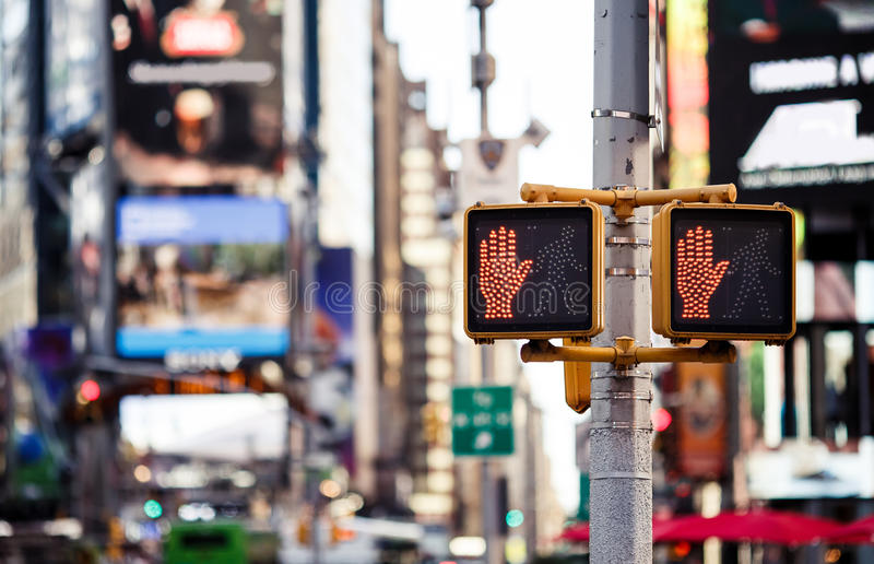 Don't walk New York traffic sign. With illuminated and blurred background stock images
