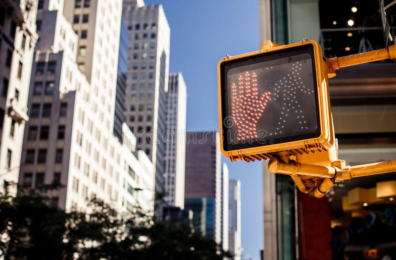 Don't walk New York traffic sign. With illuminated and blurred background royalty free stock images