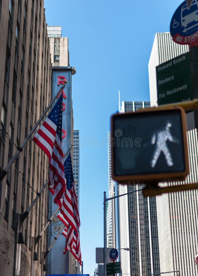 Don`t walk sign. In front of the American flags royalty free stock images