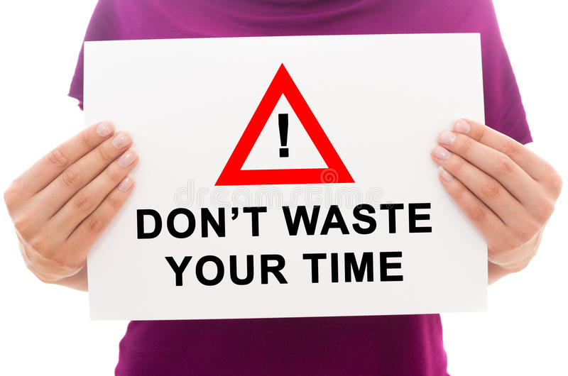 Don't waste your time. Girl holding white paper sheet with text Don't waste your time stock photos