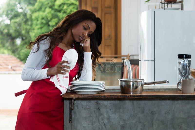 Dona de casa afro-americano frustrante imagem de stock royalty free