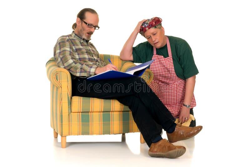 Dona de casa com marido preguiçoso fotografia de stock royalty free