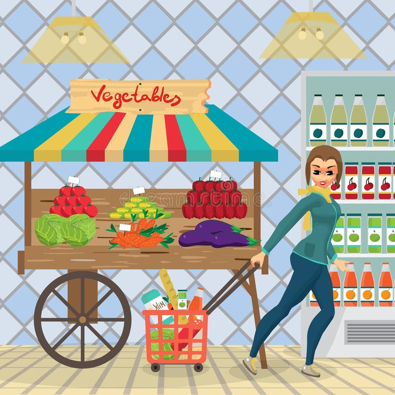 Dona de casa da jovem mulher em um supermercado com uma cesta completa do foo ilustração stock
