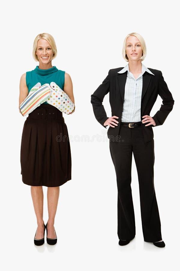 Dona de casa e mulher de negócios fotografia de stock royalty free