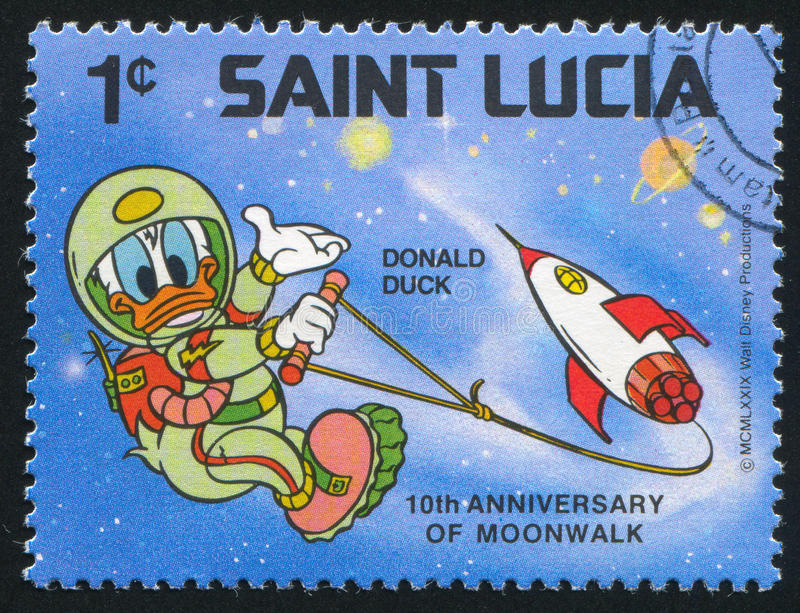 Donald Duck spacewalking. SAINT LUCIA - CIRCA 1980: stamp printed by Saint Lucia, shows shows Walt Disney Characters, Space scenes, Donald Duck spacewalking royalty free stock images