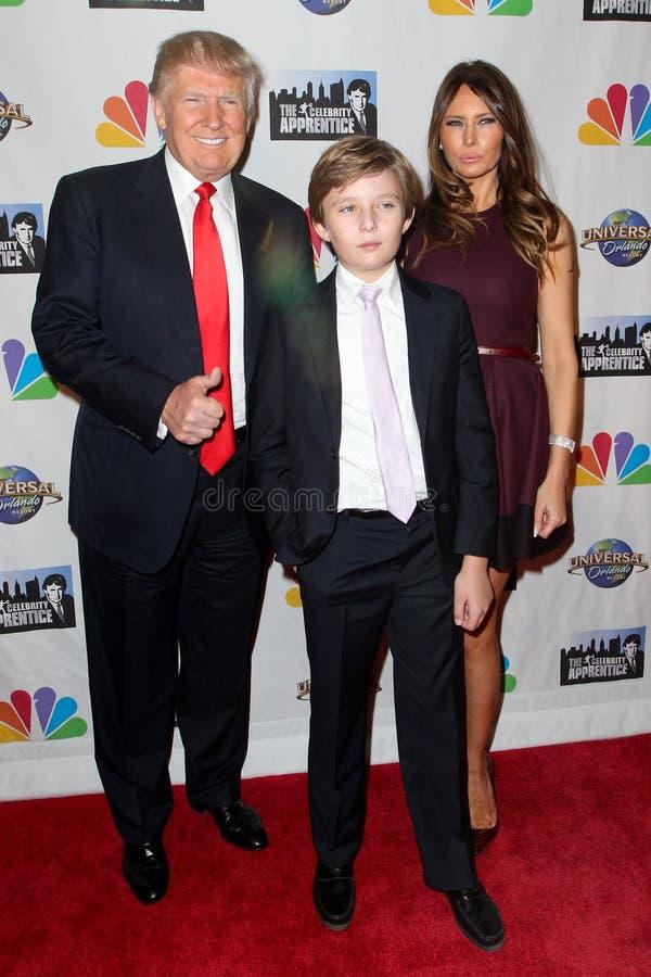 Donald Trump, Barron Trump, Melania Trump. NEW YORK-FEB 16: (L-R) Donald Trump, son Barron Trump and wife Melania Trump attend 'The Celebrity Apprentice' finale royalty free stock image