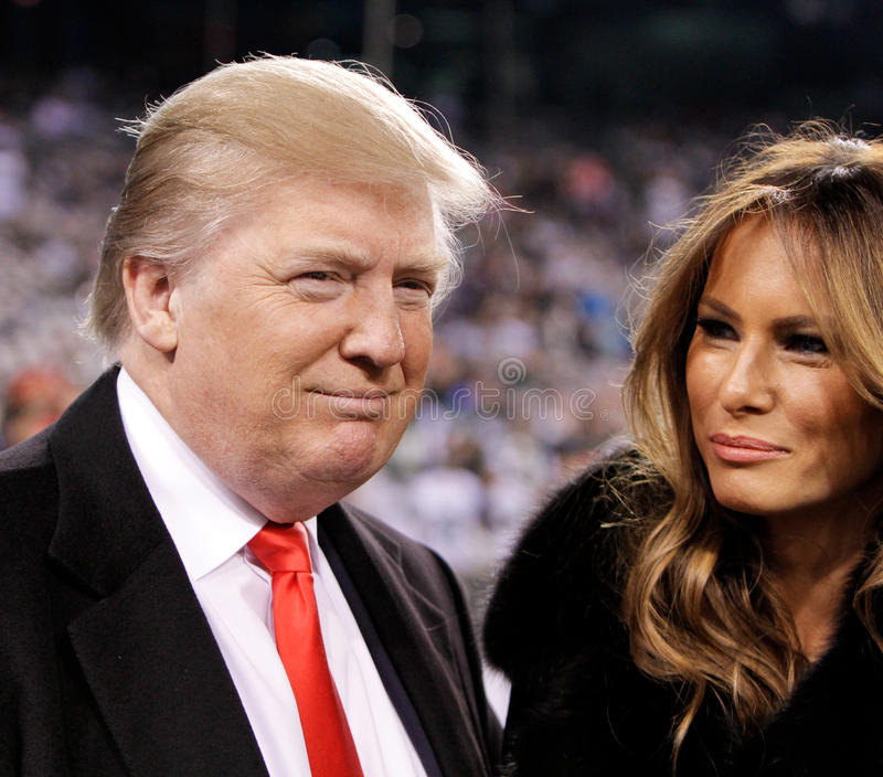 Donald Trump, Melania Trump. EAST RUTHERFORD, NJ-NOV 13: Donald Trump and wife Melania Trump before a football game at MetLife Stadium on November 13, 2011 in