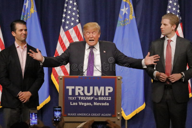 Donald Trump victory speech following big win in Nevada caucus, Las Vegas, NV. LAS VEGAS, NV - FEBRUARY 23: Donald Trump is flanked by sons Eric (Right) and royalty free stock photos