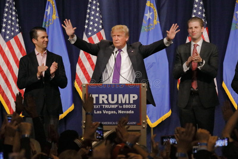 Donald Trump victory speech following big win in Nevada caucus, Las Vegas, NV. LAS VEGAS, NV - FEBRUARY 23: Donald Trump is flanked by sons Eric (Right) and stock photo