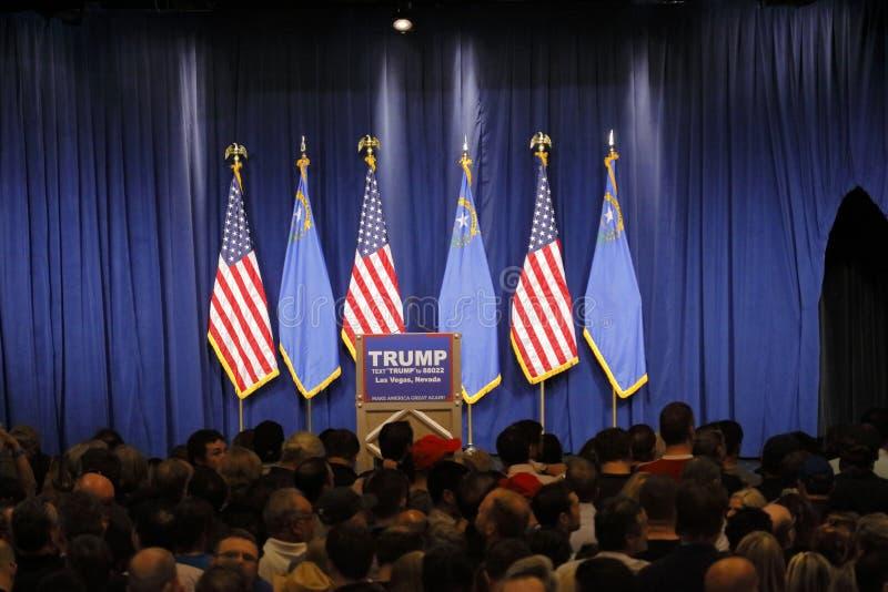Donald Trump victory speech following big win in Nevada caucus, Las Vegas, NV. LAS VEGAS, NV - FEBRUARY 23: podium and US Flags for Donald Trump, following big stock image