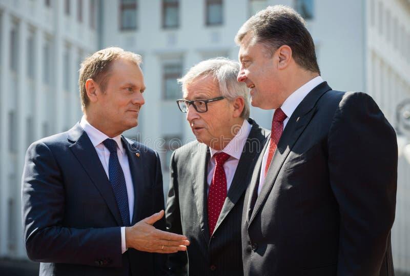 Donald Tusk, Jean-Claude Juncker und Petro Poroshenko lizenzfreie stockbilder