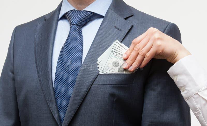 Donante de un soborno en un bolsillo imagenes de archivo