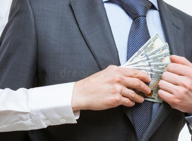 Donante de un soborno en un bolsillo fotos de archivo