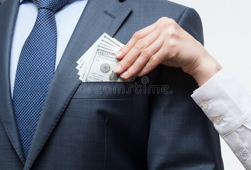Donante de un soborno en un bolsillo fotos de archivo libres de regalías