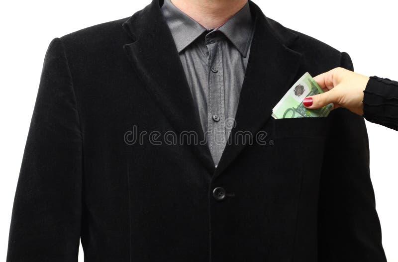 Donante de un soborno en un bolsillo del traje foto de archivo libre de regalías