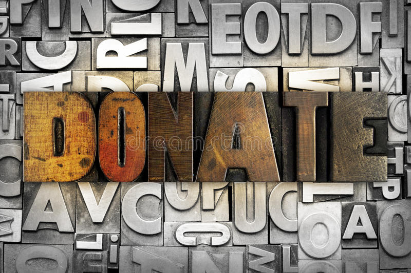 Donate. The word DONATE written in vintage letterpress type stock photography