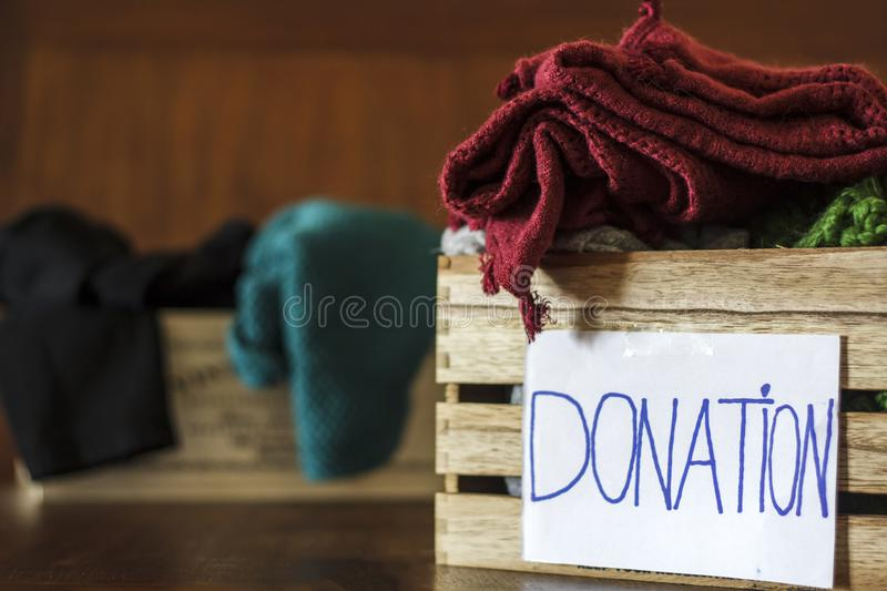 Donate Box full of Clothes. Donation Concept royalty free stock photos