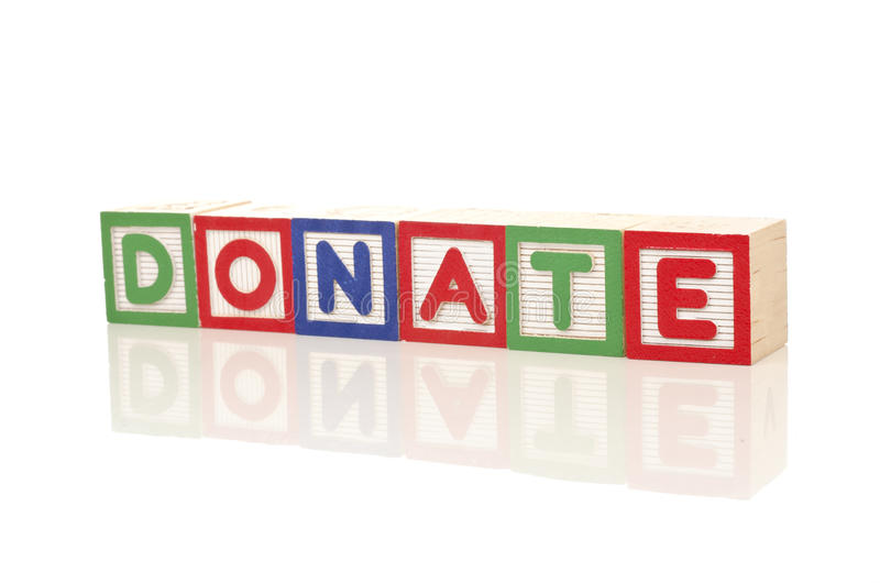 Donate campaign. Donate word on colorful wood blocks on white background stock photography