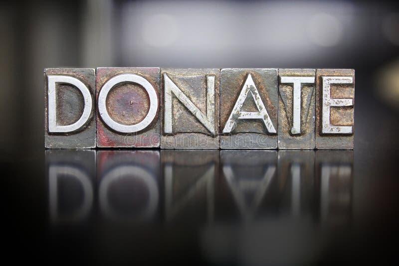 Donate Letterpress. The word DONATE written in vintage letterpress type royalty free stock image