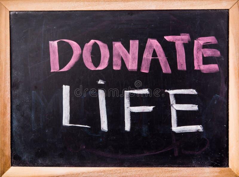 Donate life word on blackboard royalty free stock photography