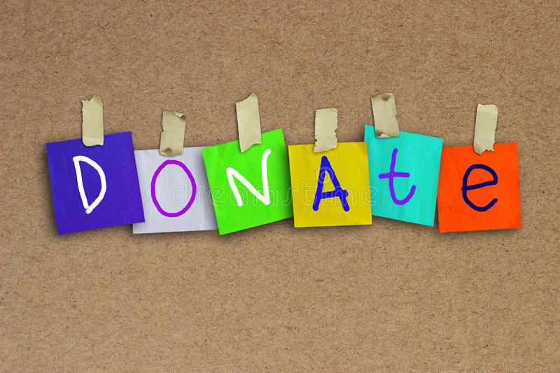 Donate. The word Donate written on sticky colored paper over corkboard texture background stock illustration