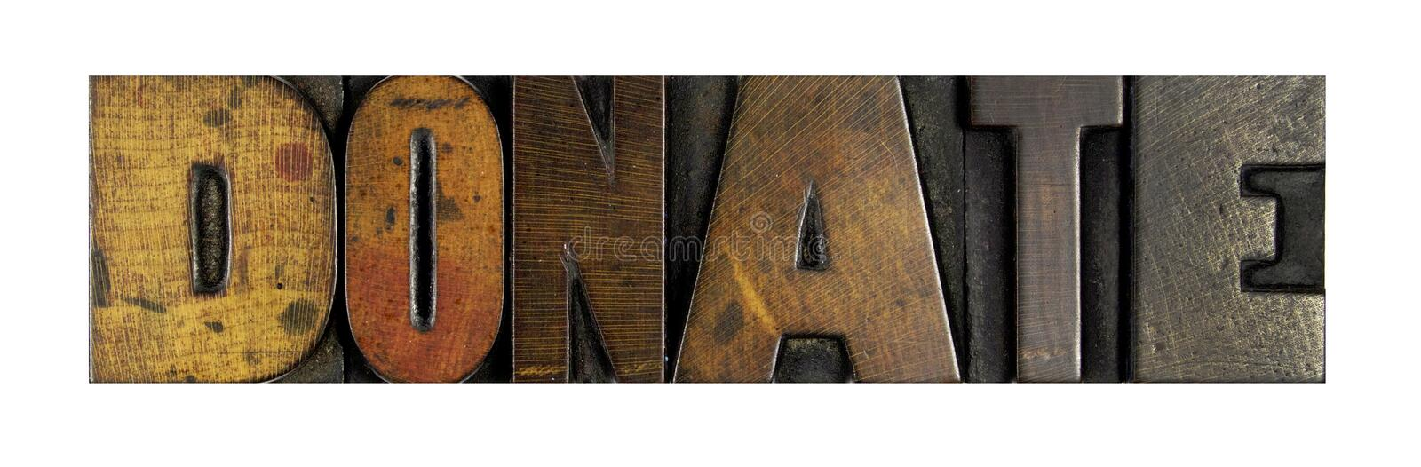 Donate. The word DONATE written in vintage letterpress type stock images