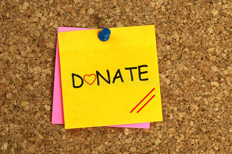 Donate. Word on yellow sticky stock photos
