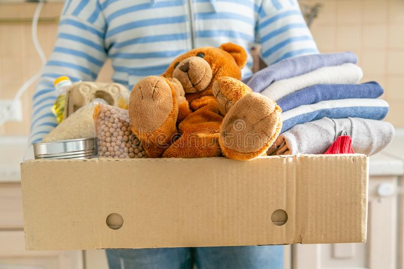 Donating concept - food, clothes, toys in cardboard royalty free stock photo