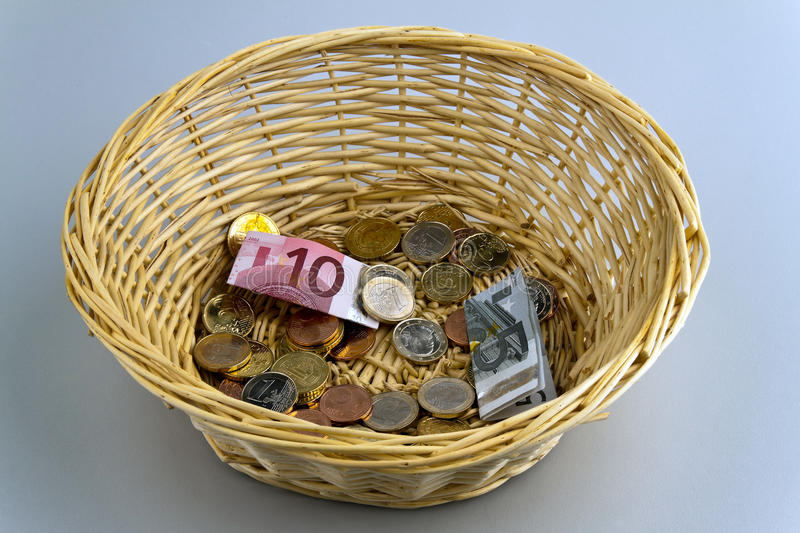 Donation basket for collection. A donation basket for collection. Monetary donation royalty free stock images