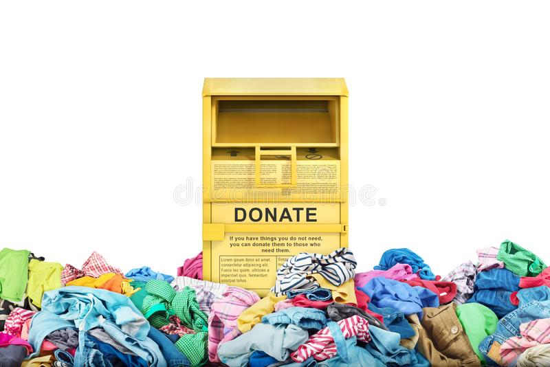 Donation box in a big pile of clothes. On a white background stock photo