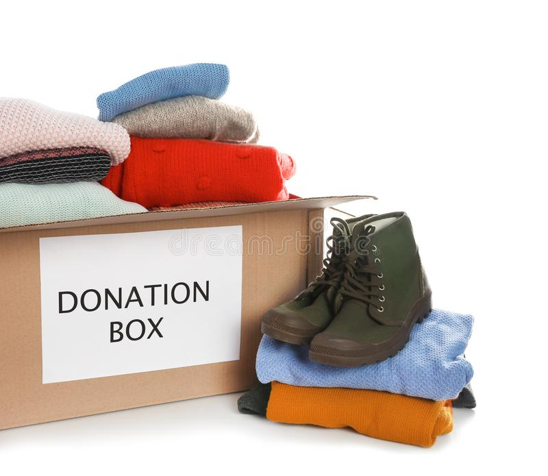 Donation box, shoes and clothes. On white background royalty free stock photography