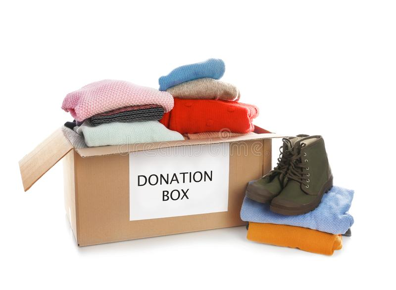 Donation box, shoes and clothes. On white background royalty free stock photos