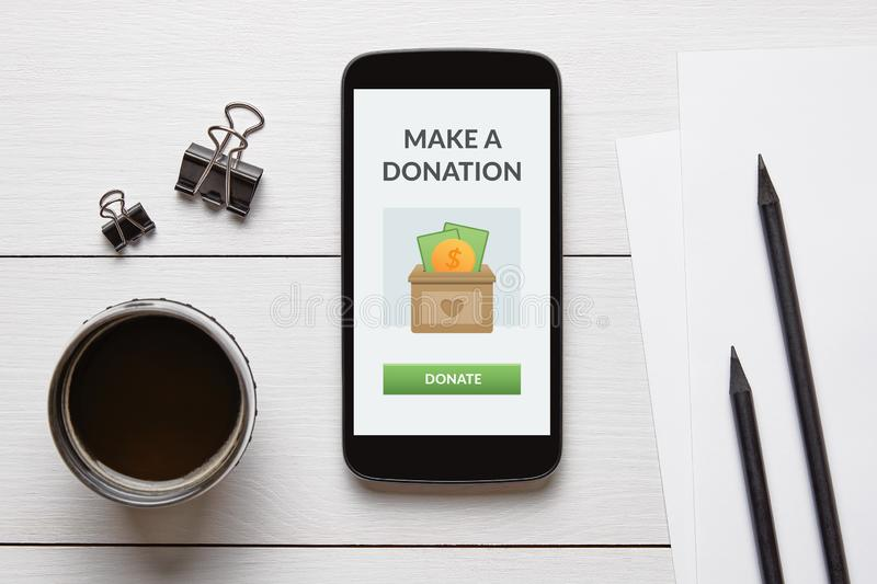 Donation concept on smart phone screen stock photo