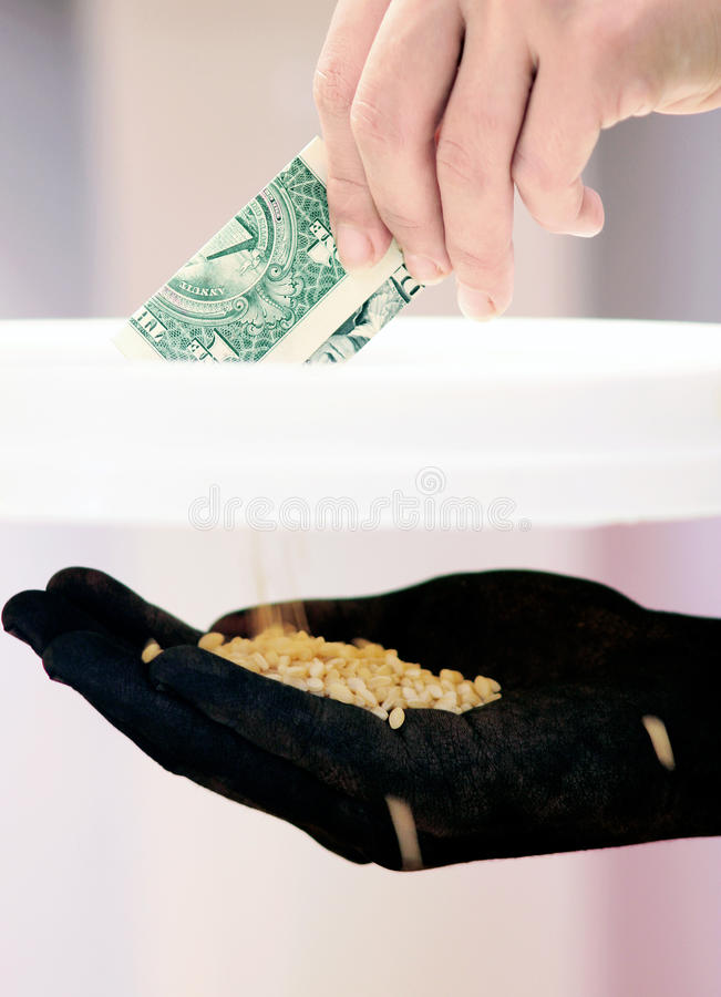 Donation. Hand giving money and hand receiving food beans as a result of the donations to stop hunger royalty free stock photography