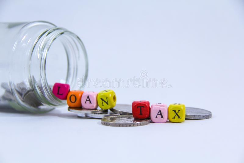 Hand putting coin in the glass jar with white background stock photo