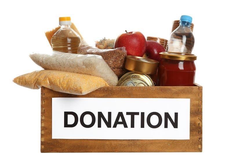 Donationask mycket av olika produkter på vit fotografering för bildbyråer