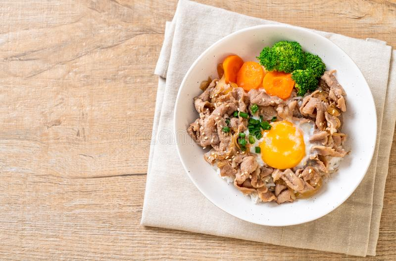 Donburi, pork rice bowl with onsen egg and vegetable. Japanese food style royalty free stock image