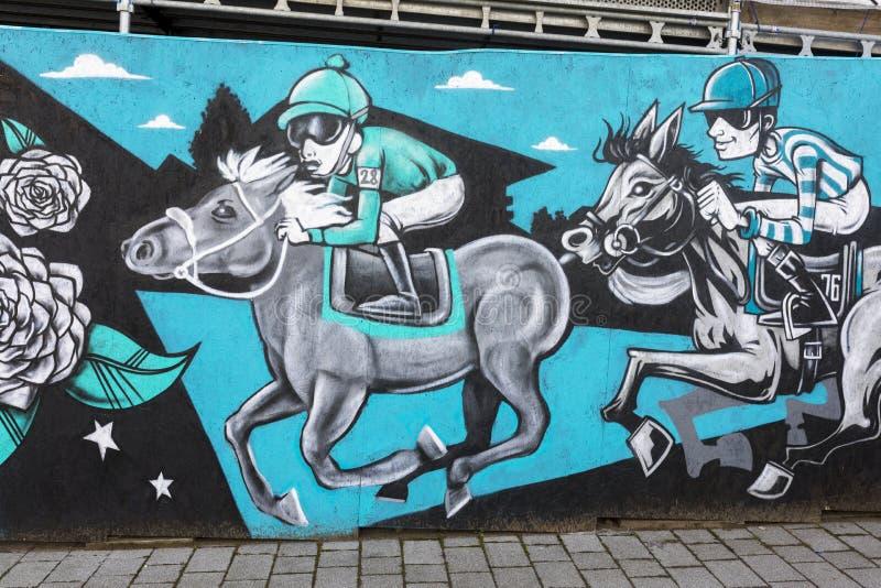 Doncaster street art mural, St Leger festival, horse racing, jockey royalty free stock image