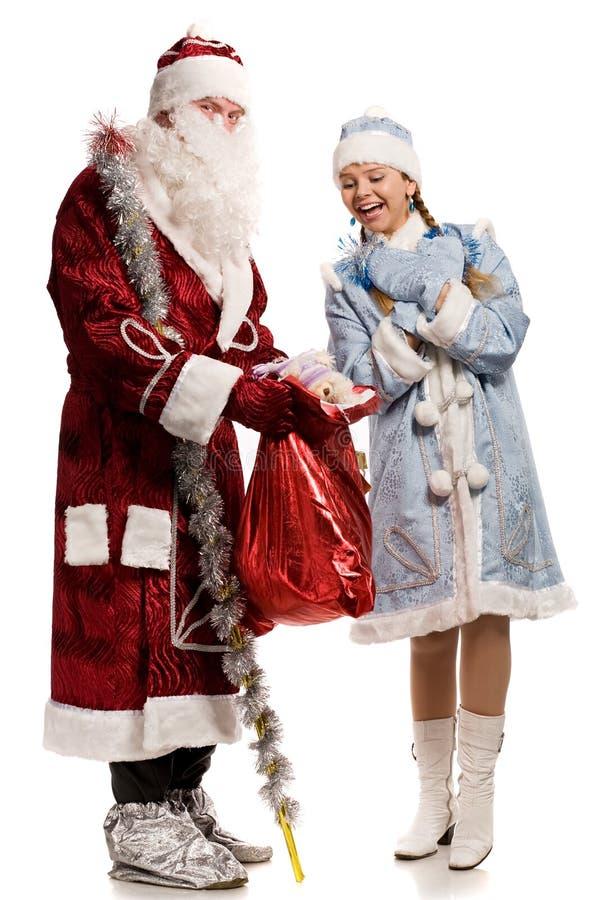 Doncella y Papá Noel sonrientes de la nieve fotos de archivo libres de regalías
