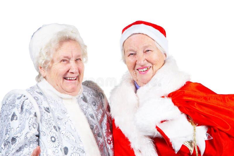 Doncella y Santa de la nieve de las viejas señoras imagenes de archivo