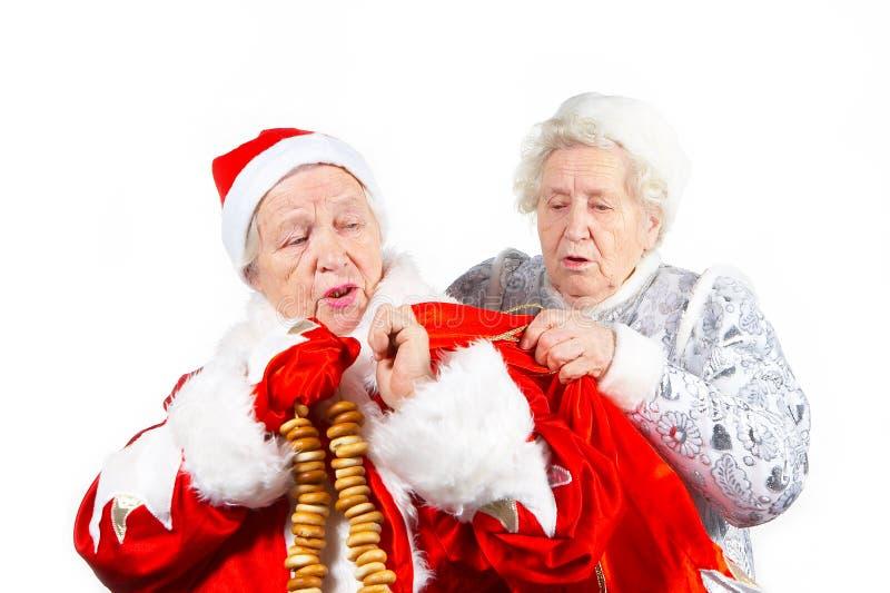 Doncella y Santa de la nieve de las viejas señoras imagen de archivo