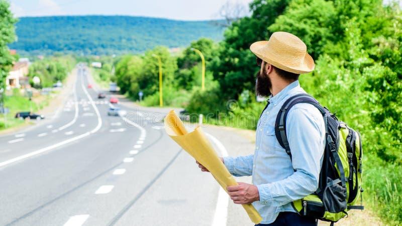 Donde debo ir El viajar perdido de la dirección del mapa turístico del backpacker En todo el mundo El mapa permite reconoce basta imagen de archivo libre de regalías