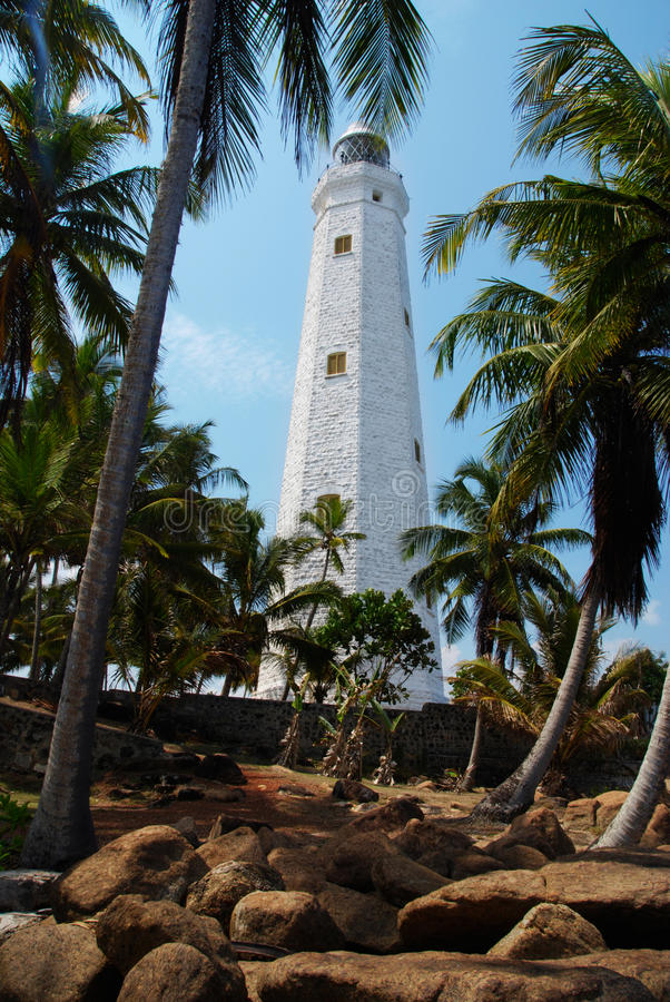 Dondra Head. Beautiful white lighthouse Dondra Head, the southest cape of Sri Lanka. The lighthouse is also a highest (161 feet) not only on the island but also stock photos