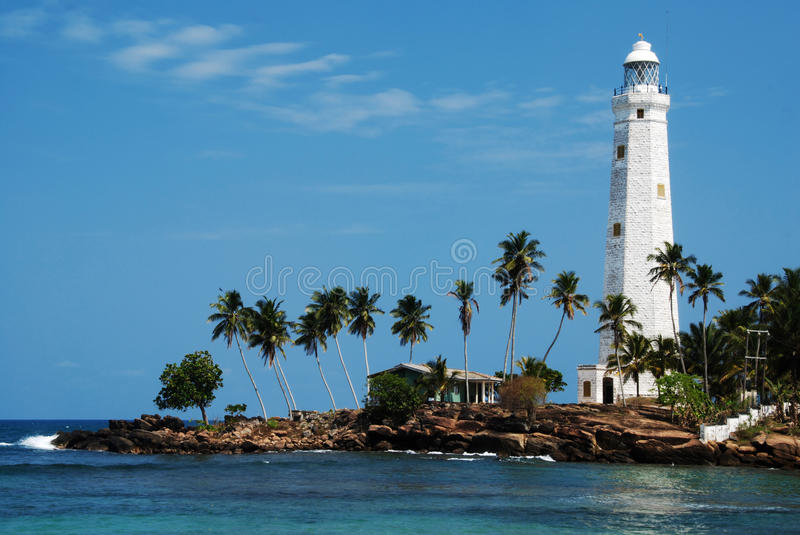 Dondra Head. Beautiful white lighthouse Dondra Head, the southest cape of Sri Lanka - seen from the beach. The lighthouse is also a highest (161 feet) not only stock photo
