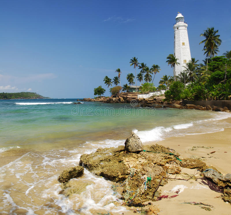 Dondra Head. Beautiful white lighthouse Dondra Head, the southest cape of Sri Lanka - seen from the beach. The lighthouse is also a highest (161 feet) not only stock photography