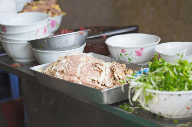 Done beef on cooking table of Pho restaurant in Hanoi street. Pho is the most famous food in Vietnam stock images