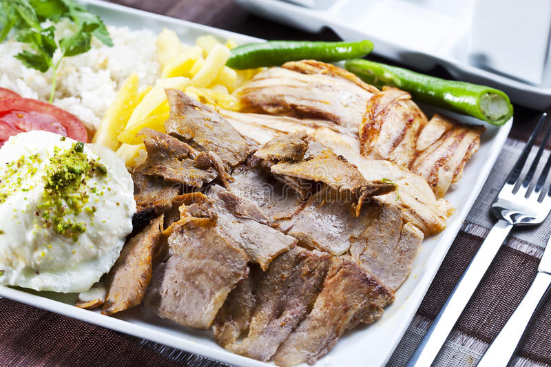 Doner Kebab. Turkish traditional food from beef and chiken with yogurt, salad and french fries royalty free stock photos