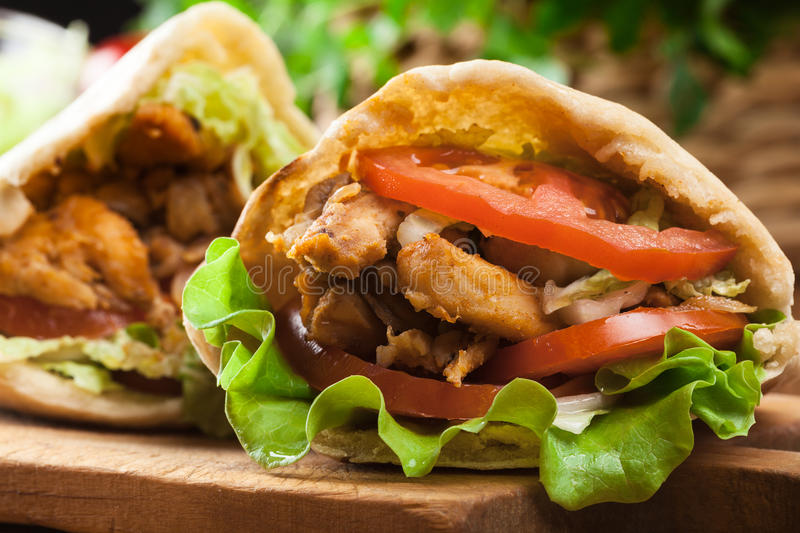 Download Doner Kebab - Fried Chicken Meat With Vegetables Stock Photo - Image of asian, snack: 77788632