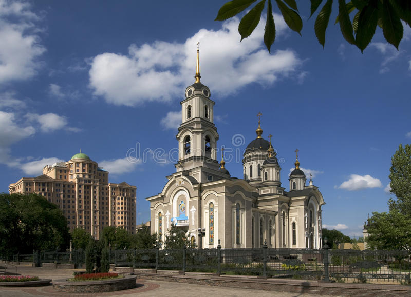 Donetsk - Nativity of Christ church. These are architecture of Donetsk city (Ukraine, disputed territory). Nativity of Christ church and modern building are royalty free stock images